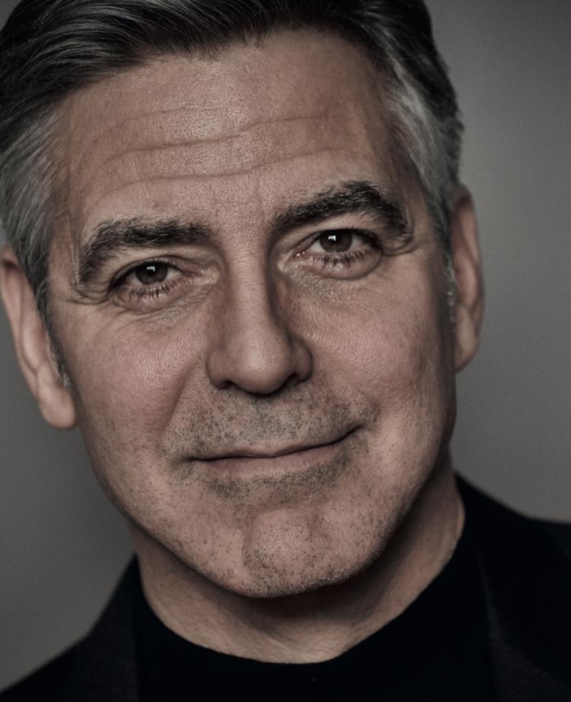 George Clooney sleept Frans blad voor de rechter voor plaatsen foto's van tweeling