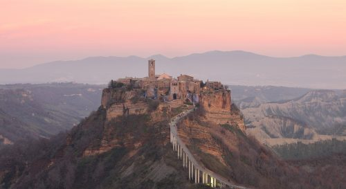 Civita di Bagnoregio was constructed in the 8th century by Etruscans and was, for a time, part of the Etruscan's principle route to Rome. It is also known as the dying city due to the slow corrosion of the tufa. Viterbo