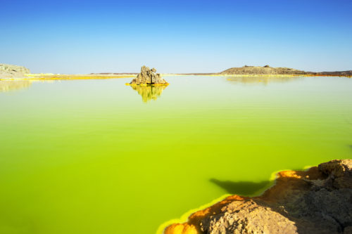 The volcanic explosion crater of Dallol in the Danakil Depresseion in Nothern Ethiopia. The Dallol crater was formed during a phreatic eruption in 1926. This crater is known as the lowest subaerial vulcanic vents in the world. The surreal colours are caused by green acid ponds and iron oxides and sulfur.