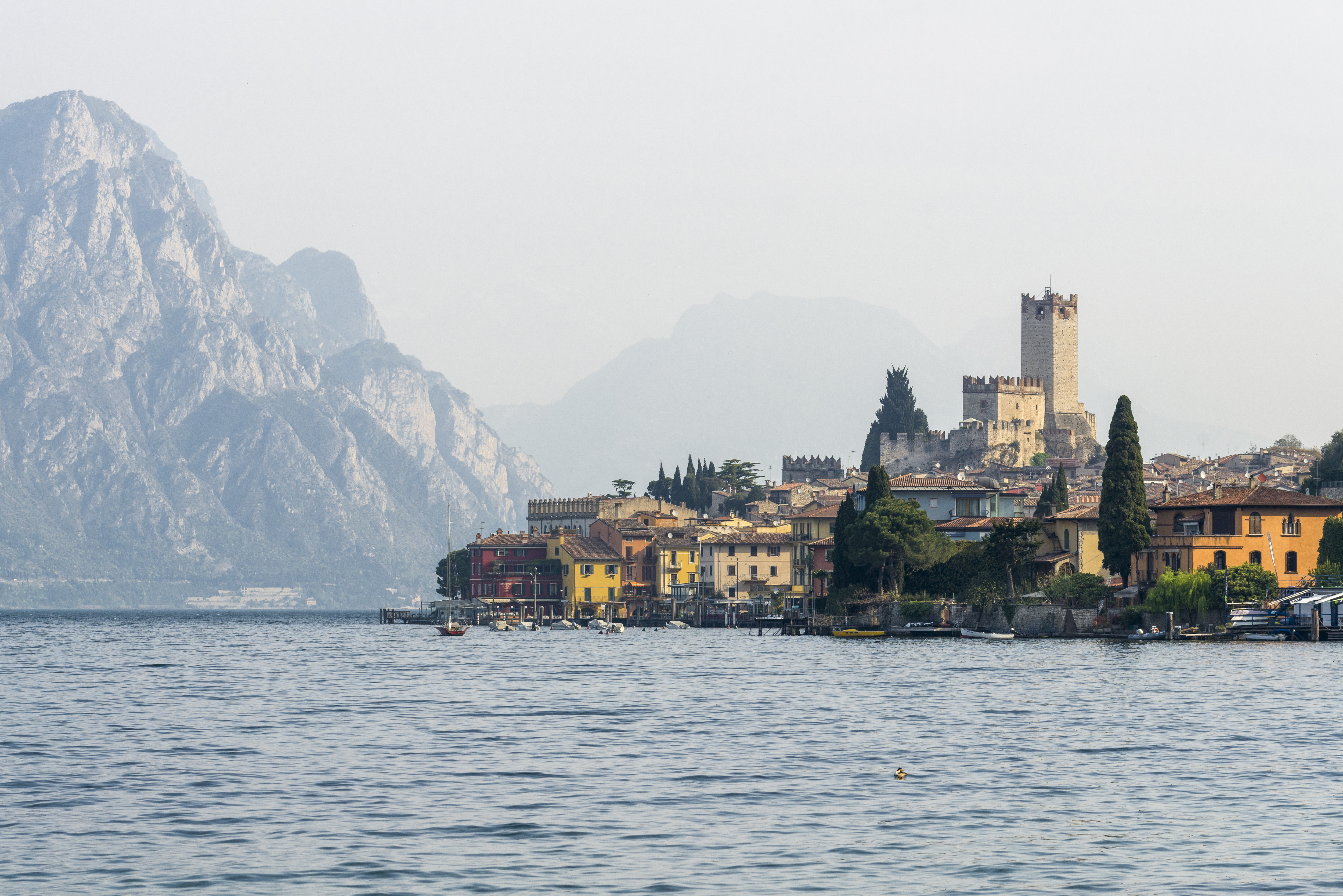 MALCESINE, VERONA, ITALY - 2015/04/16: The old town is located at the shore of Lake Garda, seen across the Waters. (Photo by Frank Bienewald/LightRocket via Getty Images)